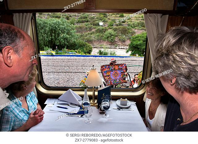 Peru Luxury train from Cuzco to Machu Picchu. Orient Express. Belmond. The waiters serve delicacies inside the Hiram Bingham Orient Express which runs between...