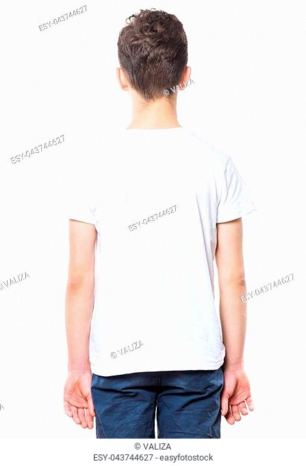 White t-shirt on teen boy. Close-up of back tshirt, isolated on a white background. Concept of childhood and fashion or advertisement design