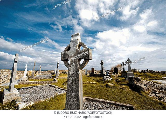 Celtic cross in Na Seacht dTeampaill (Seven Curches) graveyard celtic remains. Inishmore, biggest of Aran Islands. Galway Co. Ireland