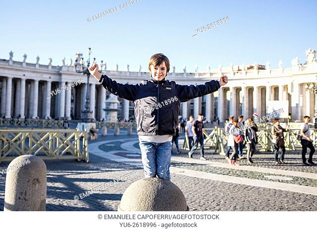 Child has fun in St Peter's Square in Rome, Italy