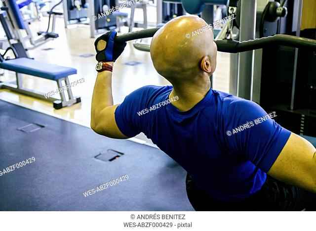 Man doing chest exercises in a gym machine