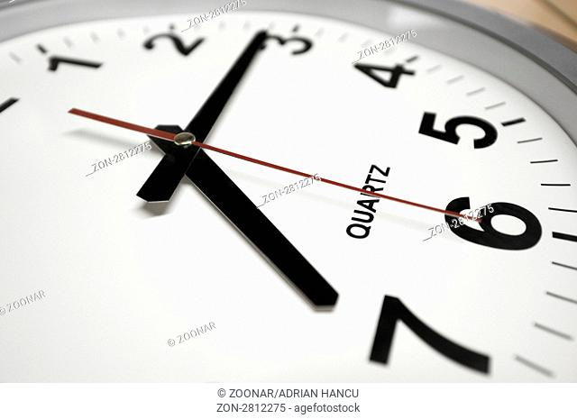 This photograph represent a wall clock. Arrows indicates 7:15 - Time to go to work!