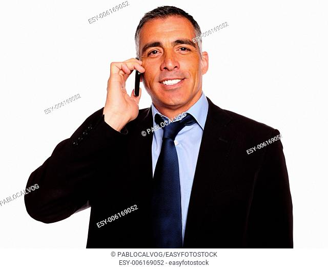 Portrait of a charismatic businessman speaking on cellphone with a attractive smile against white background