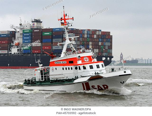 Rescue cruiser Hermann Helms of the German Maritime Search and Rescue Service (DGzRS) meets container ship Yang Ming Uniformity on the Elbe in front of its...