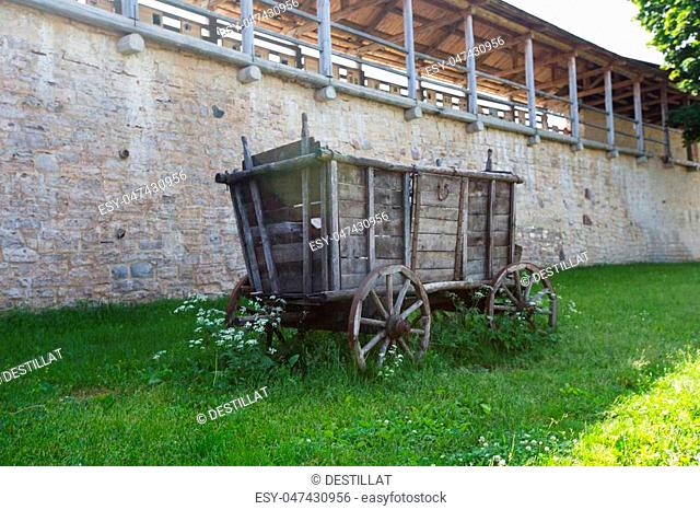 IZBORSK, PSKOV, RUSSIA 18,06,2018 A view of the old Izborsk fortress walls and vintage wooden cart