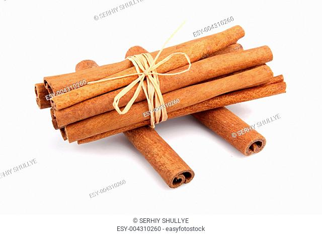 Bunch of cinnamon sticks isolated on white