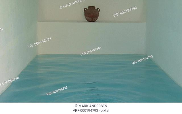 A woman emerging out of an indoor pool