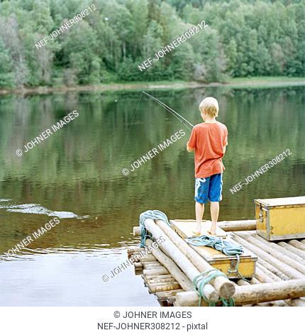 A boy fishing, Sweden