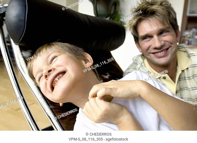 Close-up of a father smiling with his son