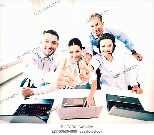 business concept - group of office workers showing thumbs up in call center