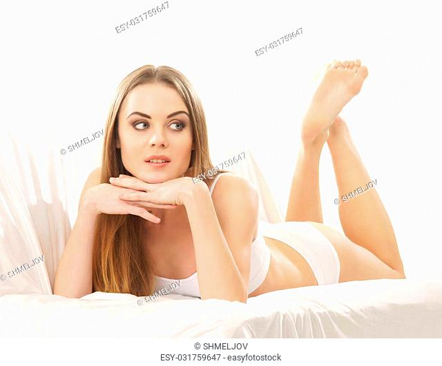 Young sexy woman on the sofa