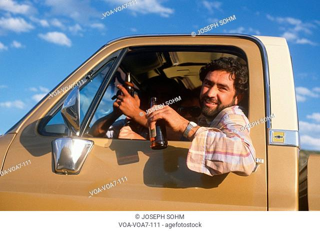A Mexican-American in a pickup truck with a beer bottle, Chimayo, NM