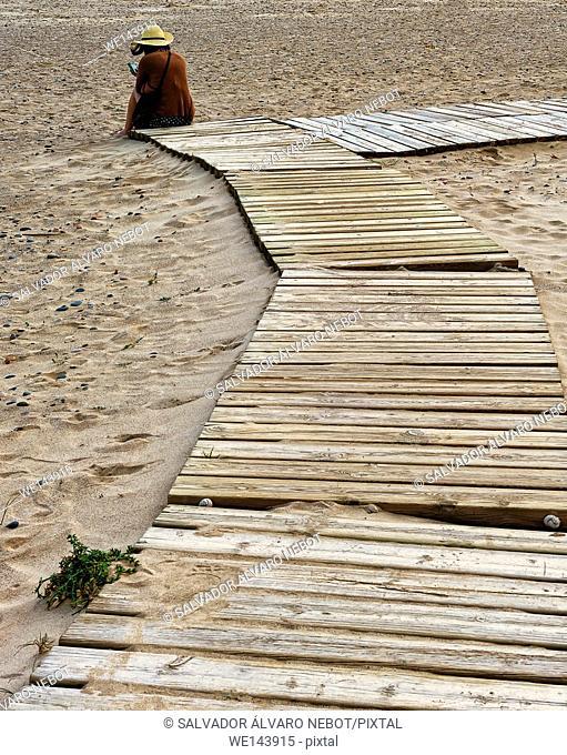 Reading on the beach, Beach Canet de Berenguer, Valencia, Valencia, Spain