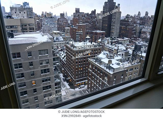 New York City, Manhattan. Blizzard Snow Storm Seen from Above East 69th Street and Lexington Avenue , Through a High Floor Apartment Window. Late Day