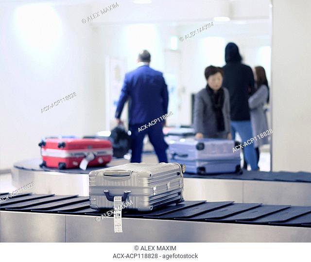 Suitcases, luggage on airport baggage claim conveyor carousel, Tokyo Haneda International Airport, Japan
