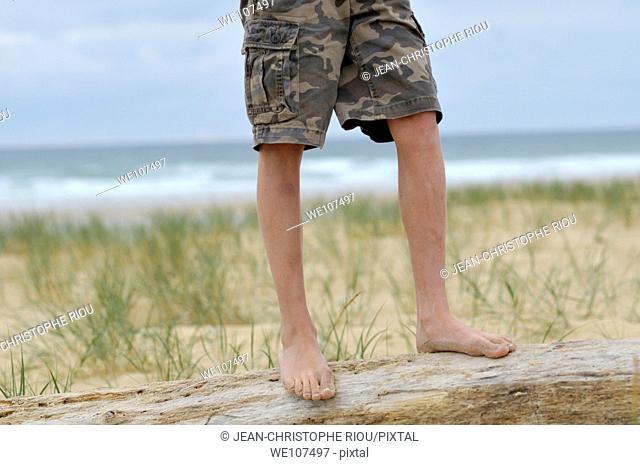 Boy's legs near the sea