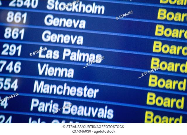 Monitor showing flight arrivals and departures. Heathrow International Airport. London. England. UK