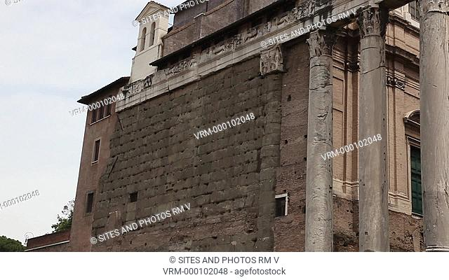 PAN, TILT up, CU, Daylight. Exterior: The Temple of Antoninus and Faustina was built by Emperor Antoninus Pius in 141 AD