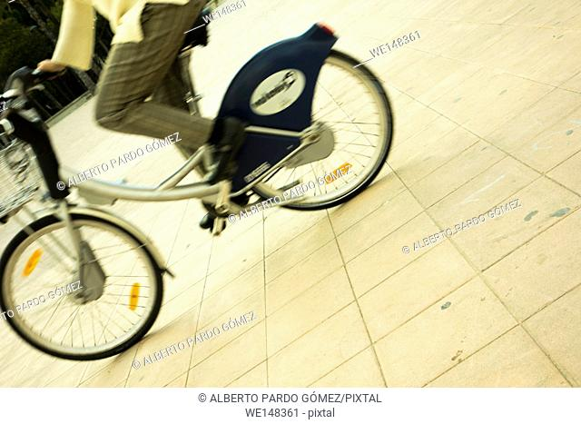 Person cycling in valencia, Spain
