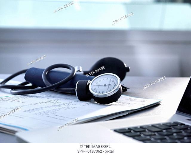 Blood pressure gauge sitting on a doctors desk