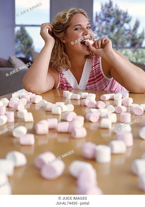 View of woman eating marshmallows