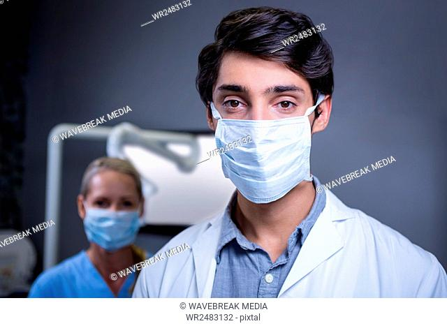Portrait of dentist and dental assistant wearing surgical mask