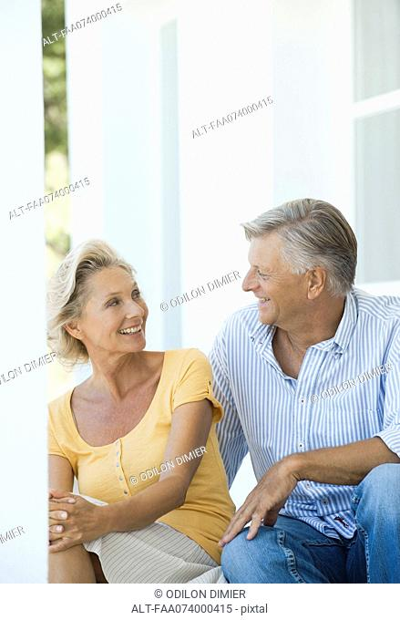 Mature couple sitting together outdoors