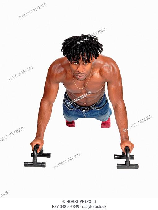 A muscular African American man working out on the floor with push.aps, looking into the camera, isolated for white background