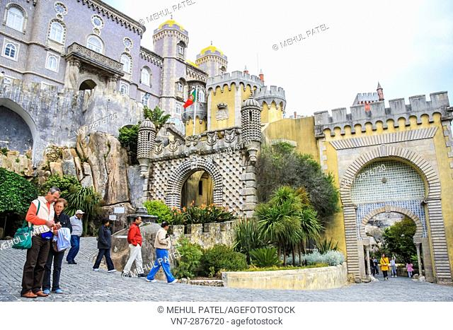 Visitors outside the entrance gates to the Pena National Palace, Sintra, Lisbon, Portugal. The palace is situated in the eastern part of the Park of Pena