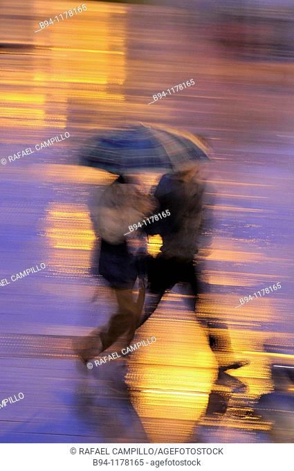 People with umbrellas in a rainy day, Barcelona, Catalonia, Spain