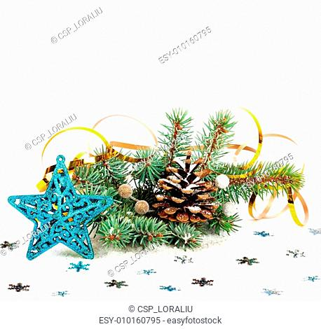 Christmas tree branch with gold serpentine and star on white bac