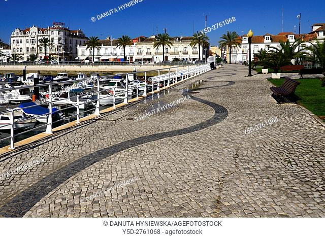 marina on Guadiana river being natural border between Spain (Andalusia) and Portugal (Algarve), waterfront buildings along Av