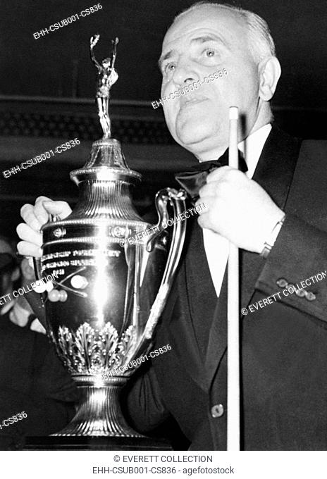 Billiards Champion, Willie Hoppe, with trophy for the World's Three Cushion Billiard Championship. He defeated Jake Schaefer of Chicago