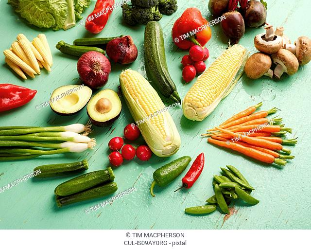 Overhead view of vegetables on green background