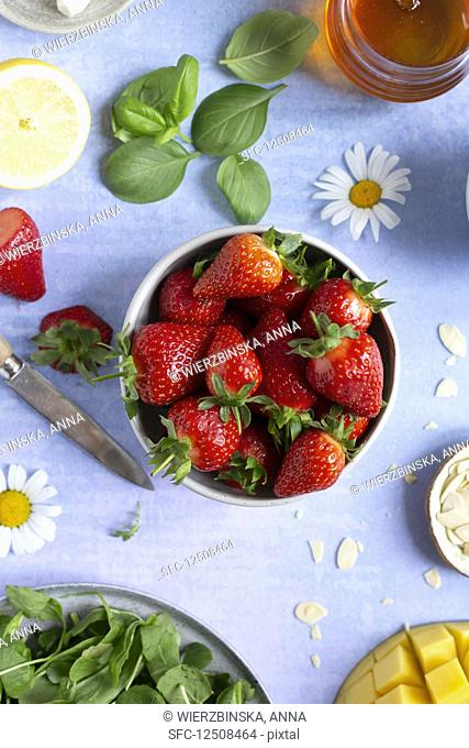 Small bowl of fresh strawberries on a vibrant background