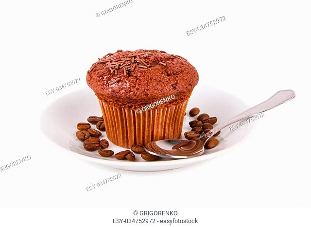 Chocolate muffins and coffee beans on a white plate isolated on white background