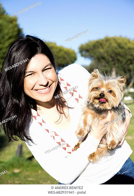 Portrait of happy young woman with her Yorkshire Terrier