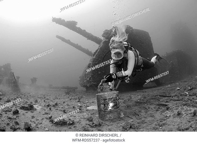 Diver finds Artifacts on Flight Deck of USS Saratoga, Bikini Atoll, Micronesia, Pacific Ocean, Marshall Islands