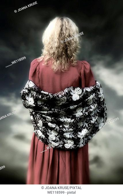 a woman with a red dress and a shawl