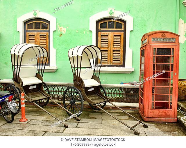 trishaws and phone booth at the Pinang Peranakan Mansion in Georgetown, Penang, Malaysia