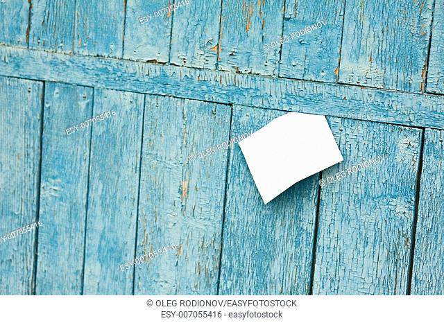 Sheet of Paper on Old Blue Wooden Background. Selective Focus