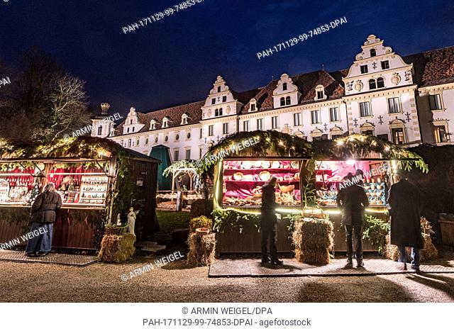 View of the romantic Christmas market at the St. Emmeram Castle, also known as Thurn und Taxis Castle, in Regensburg, Germany, 29 November 2017
