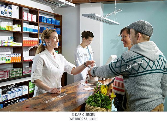 Couple in Drugstore, Munich, Bavaria, Germany
