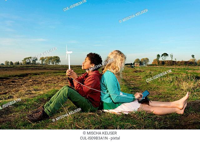 Children using miniature wind turbine to power digital tablet, Breda, Netherlands