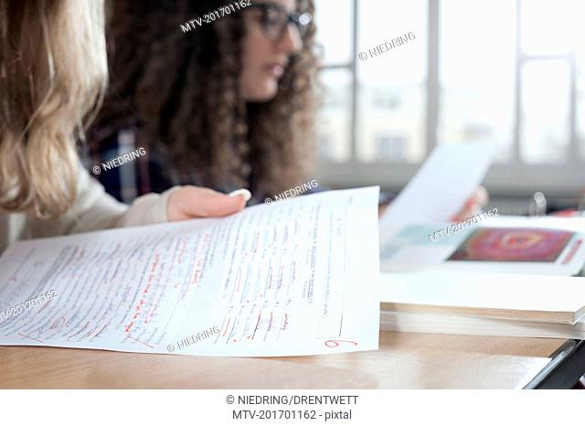 University students looking at her test results, Bavaria, Germany