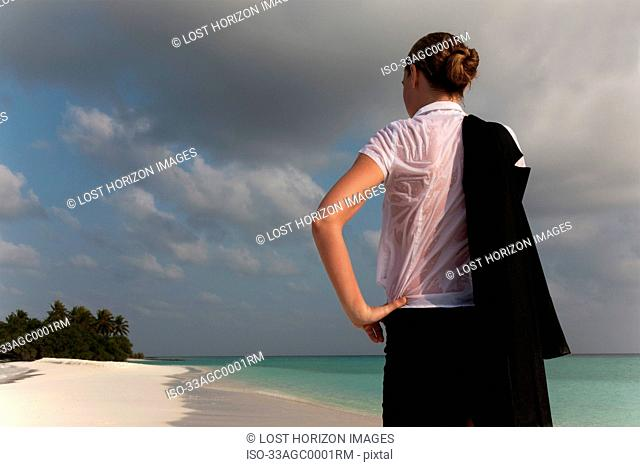 Woman wearing wet clothes on beach