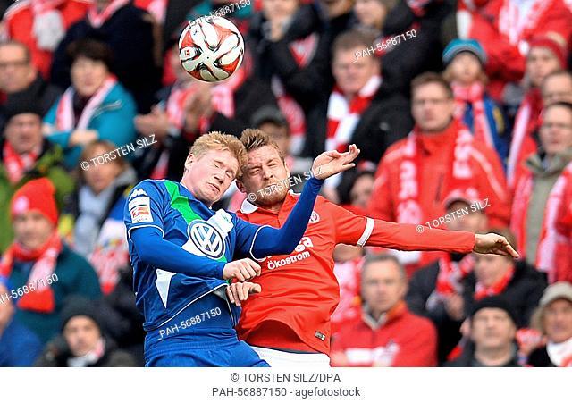 Mainz's Daniel Brosinski (R) and Wolfsburg's Kevin De Bruyne vie for the ball during the German Bundesliga soccer match between 1