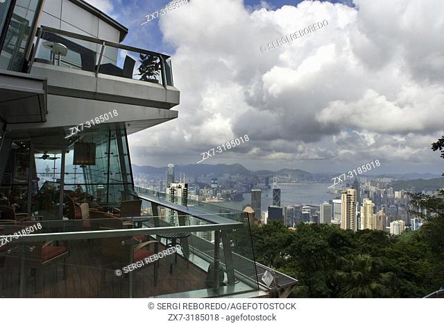 Tourists enjoy the views from the Sky Terrace on the from Victoria Peak Tower. Hong Kong, China, SAR