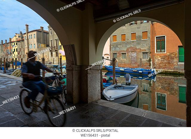 Chioggia, Two of the main ways of moving around the city, boat and bicycle. Veneto, Italy