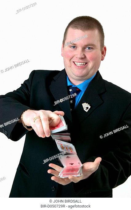 Magician performing a magic trick with a pack of cards